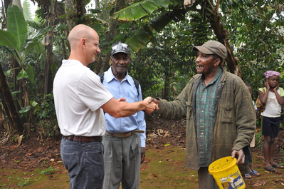 Willy Foote with farmer in Haiti